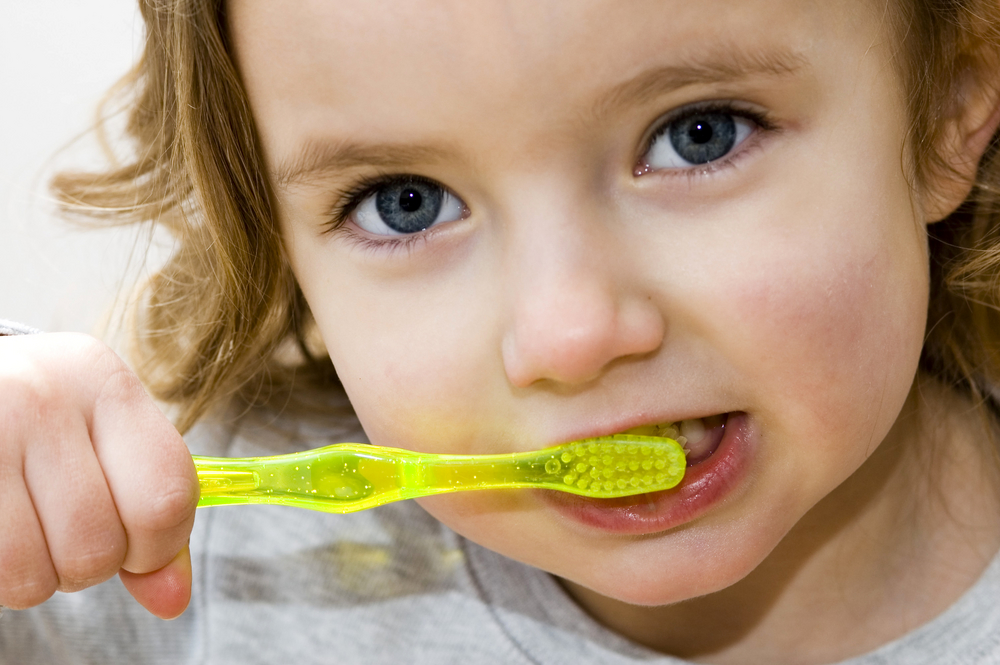 Girl Brushing - Pediatric Dentist in Brownsville, Tx